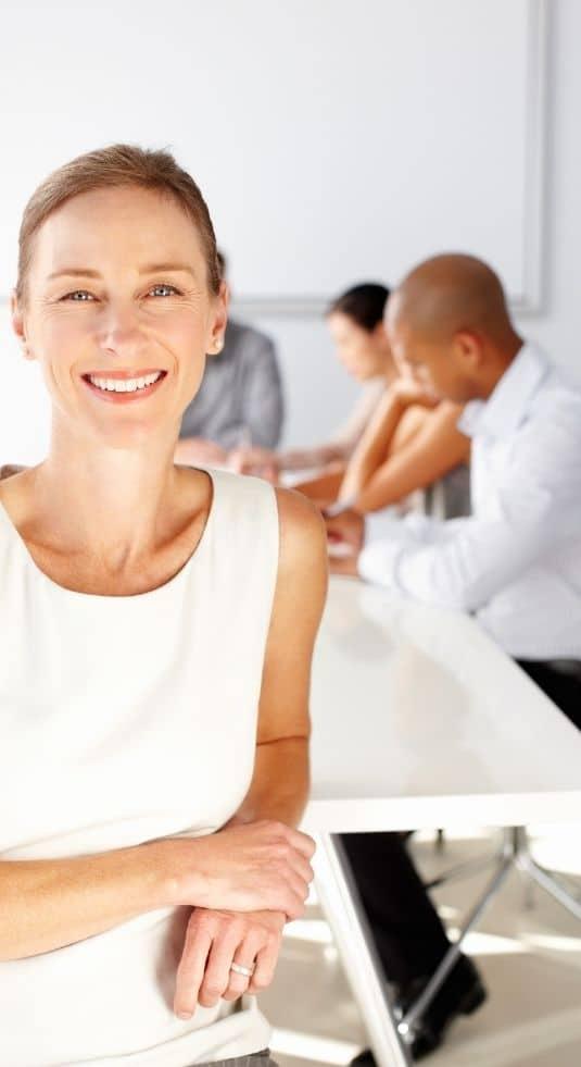 Scion Denver Executive Search team around a table at a meeting